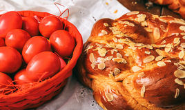 Easter eggs and greek tsoureki on a table Stock Photos