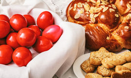Easter eggs and greek tsoureki on a table Royalty Free Stock Photo