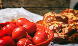 Easter eggs and greek tsoureki on a table Royalty Free Stock Photography