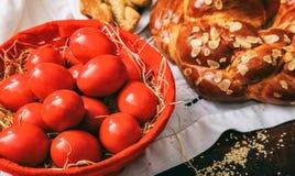Easter eggs and greek tsoureki on a table Stock Photography