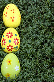 Easter eggs on a green background Stock Photo