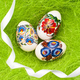 Easter eggs on green background Stock Photos