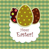 Easter eggs on green checkered backgr. Postcard with Easter eggs on green checkered background Stock Photography