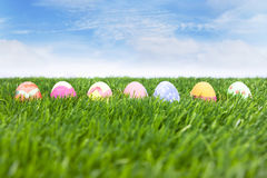Easter eggs on green field Stock Images