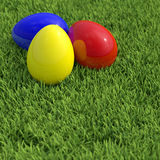Easter eggs on green grass. Three colorful easter eggs on green grass Royalty Free Stock Photo