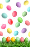 Easter eggs in green grass and flying in the air Stock Photo