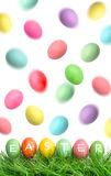 Easter eggs in green grass and flying in the air Royalty Free Stock Photo