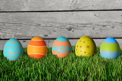 Easter eggs in green grass. Happy Easter Royalty Free Stock Images