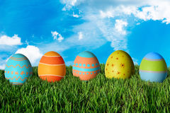 Easter eggs in green grass. Happy Easter Stock Photography