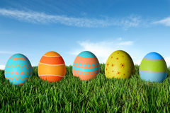 Easter eggs in green grass. Happy Easter royalty free stock photography