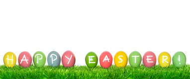 Easter eggs in green grass. Holidays banner Happy Easter Stock Photography