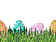 Easter eggs and green grass seamless horizontal ornament. Patter Stock Image