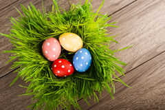 Easter eggs on green grass on table Royalty Free Stock Images