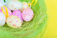 Easter eggs in green nest Royalty Free Stock Images