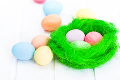 Easter eggs in green nest Stock Images