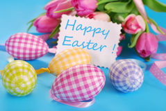 Easter eggs with greeting card and tulips Royalty Free Stock Image