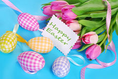 Easter eggs with greeting card and tulips Stock Photography
