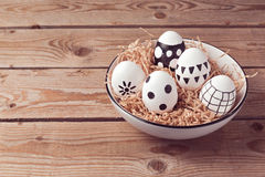 Easter eggs with hand drawing ornament on wooden background Stock Images