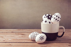 Easter eggs with hand drawing ornament on wooden table Royalty Free Stock Photo