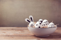 Easter eggs with hand drawing ornament on wooden table Stock Photo