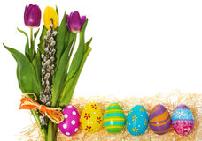 Easter eggs hand painted with a bouquet of flowers tulips, catki Royalty Free Stock Photos