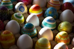 Easter eggs hand painted. Easter eggs handmade illuminated by bright sunlight Stock Photography