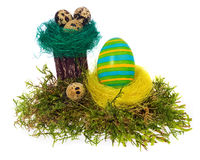 Easter eggs hand painted multicolored in bird nest, forest moss, Royalty Free Stock Photos