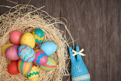 Easter eggs hand painted, rabbit, wood background Stock Image