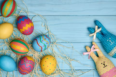 Easter eggs hand painted, rabbits, wood background Royalty Free Stock Photo