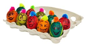 Easter eggs, hand-painted with smiling and terrified cartoon fac. Es. Decorated eggs with funny colorful hairstyles put in a cardboard box, container for eggs Royalty Free Stock Images