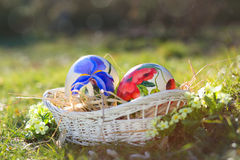 Easter eggs hand painted in a wicker basket Stock Photography
