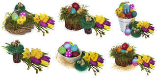 Easter eggs hand painted in a wicker wreath, bird`s nest of moss stock photo