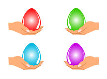 Easter Eggs in hand Stock Images