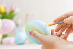 Easter eggs handicrafted with pastel stripes. Royalty Free Stock Photo