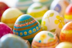 Easter eggs hand painted. Easter eggs handmade illuminated by bright sunlight Royalty Free Stock Photo