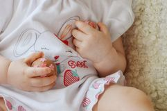 Easter eggs in the hands of a child. stock photography
