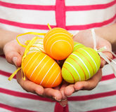 Easter eggs by hands Stock Photography