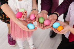 Easter eggs in the hands of  family. Easter eggs in hands close-up Stock Image