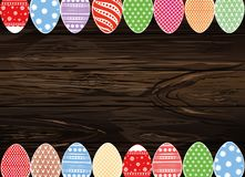 Easter eggs hang on a ribbon with bows. Greeting card or invitat. Ion for a holiday. Free space for text. Vector on wooden background Royalty Free Stock Photo