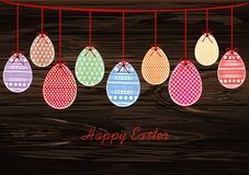 Easter eggs hang on a ribbon with bows. Greeting card or invitat. Ion for a holiday. Free space for text. Vector on wooden background royalty free illustration