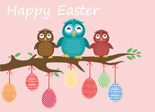 Easter eggs hang on ribbons. Lovely owls are sitting on a tree. Branch. Greeting card or invitation for a holiday. Vector royalty free illustration