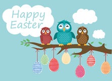 Easter eggs hang on ribbons. Lovely owls are sitting on a tree. Branch. Greeting card or invitation for a holiday. Vector Royalty Free Stock Photos