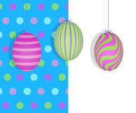 Easter Eggs Hanging on a Blue Polka Dot Background Stock Photography