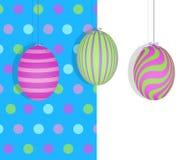 Easter Eggs Hanging on a Blue Polka Dot Background stock illustration