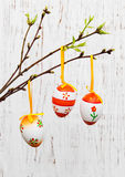 Easter eggs hanging on a branch Stock Photography
