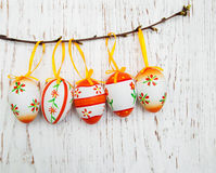 Easter eggs hanging on a branch Stock Image