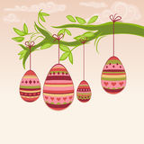 Easter eggs hanging from a branch. Doodle easter illustration with multicolor painted eggs hanging from a branch Royalty Free Stock Image