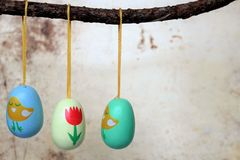 Easter eggs, hanging from a branch,. Three small easter eggs, hanging from a branch, decoration for Easter branches Royalty Free Stock Photos