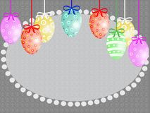 Easter eggs hanging in color ribbons with bows stock image