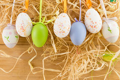 Easter eggs hanging. From the colorful ropes Stock Images